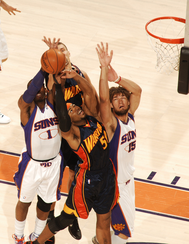 Amare Stoudemire (#1) and Robin Lopez (#15) of the Phoenix Suns fight for a rebound with Corey Maggette (#50) of the Golden State Warriors in an NBA Game played on January 23, 2010 at U.S. Airways Center in Phoenix, Arizona. photo appears courtesy of   NBAE/Getty Images/ Barry  Gossage  .........