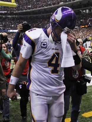 Minnesota Vikings quarterback Brett Favre wipes his face as he leaves the field following their loss to the New Orleans Saints the NFC Championship NFL football game in New Orleans, Sunday, Jan. 24, 2010. The Saints defeated the Vikings 31-28 to advance to the Super Bowl against the Indianapolis Colts. It may  well  have  been the  <strong>  last  professional  game played  by   Favre in an  NFL  uniform. </strong> But  somehow this  all  could  turn  out to  be  more of  the  <strong>'usual dramatic soap opera' </strong> that we've come use  to  seeing  from  Favre  over the  last  couple  of  years .   photo appears  courtesy  of   Associated Press/ Morry  Gash .......