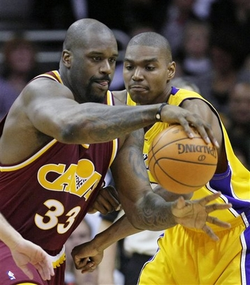 Cleveland Cavaliers' Shaquille O'Neal (33) tries to get past Los Angeles Lakers' Andrew Bynum, right, in the fourth quarter of an NBA basketball game Thursday, Jan. 21, 2010, in Cleveland. The Cavaliers won 93-87.  photo appears  courtesy  of  Associated Press/ Tony  Dejak ...........