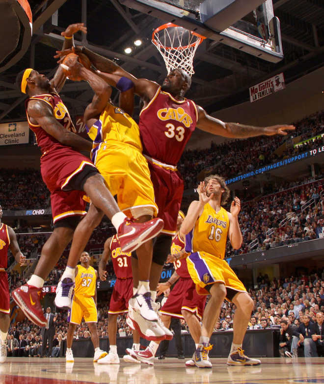 Kobe Bryant (#24) of the Los Angeles Lakers goes up for the shot against LeBron James (#23) of the Cleveland Cavaliers and is fouled by Shaquille O'Neal (#33) on January 21, 2010 at The Quicken Loans Arena in Cleveland, Ohio. photo  appears  courtesy  of  NBAE/Getty Images/  David  Liam  .......