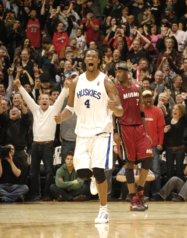 <strong> Chris Bosh (#4)</strong> of the Toronto Raptors celebrates a basket late in the game against<strong> Jermaine O'Neal (#7) </strong>of the Miami Heat during a game on January 27, 2010 at the Air Canada Centre in Toronto, Ontario, Canada. The  Raptors  would  go  on  to defeat the  Heat  <strong>111-103 </strong> in  the  match-up  between  the   two   Eastern  Conference  foes.  photo  appears  courtesy  of  <strong> NBAE/Getty Images/</strong>  Ron Turner  ...............