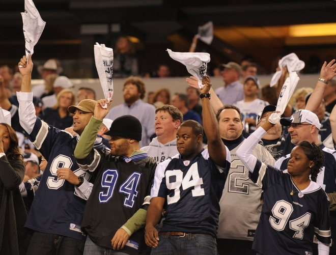 Fans of the Dallas Cowboys cheer in the stands during the 2010 NFC wild-card playoff game against the Philadelphia Eagles at Cowboys Stadium on January 9, 2010 in Arlington, Texas. picture appears  courtesy of Getty Images/ Ronald Martinez ...........