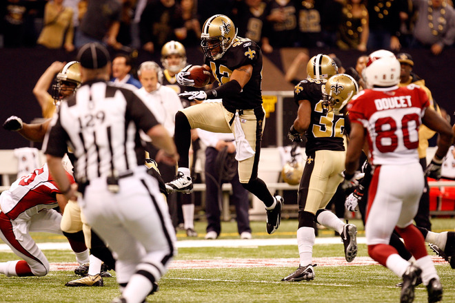 Darren Sharper (#42) of the New Orleans Saints leaps a teammate as he returns a recovered fumble for positive yards in the first quarter against the Arizona Cardinals during the NFC Divisional Playoff Game at Louisana Superdome on January 16, 2010 in New Orleans, Louisiana.  picture appears courtesy of  Getty Images/  Ronald Martinez ............