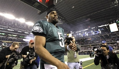 Philadelphia Eagles quarterback Donovan McNabb (5) leaves the field after losing an NFL wild-card playoff football game against the Dallas Cowboys, Saturday, Jan. 9, 2010, in Arlington, Texas. The Cowboys defeated the Eagles 34-14.  picture appears  courtesy of  ap/photo/ David  J.  Phillip .....