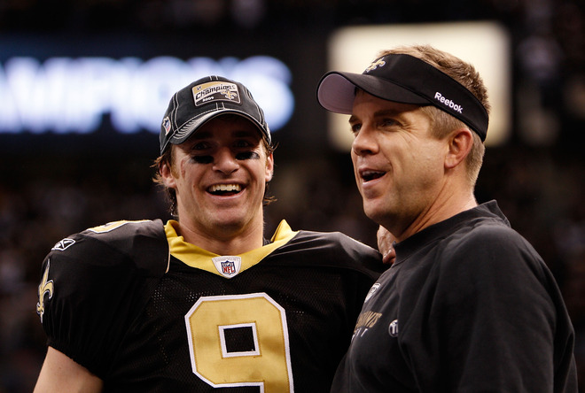 (L-R) Drew Brees (#9) and head coach Sean Payton of the New Orleans Saints celebrate after the Saints' <strong>31-28 overtime win</strong> against the Minnesota Vikings during the NFC Championship Game at the Louisiana Superdome on January 24, 2010 in New Orleans, Louisiana.  photo appears  courtesy of  Getty  Images/  Chris  Graythen  ...................