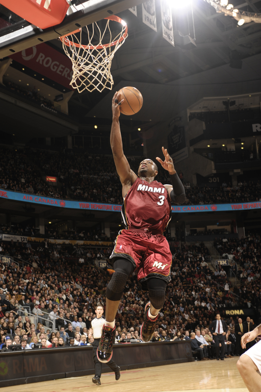 <strong> Dwyane Wade (#3) </strong> of the Miami Heat lays one in against the Toronto Raptors during a game on January 27, 2010 at the Air Canada Centre in Toronto, Ontario, Canada.  photo  appears courtesy  of  <strong> NBAE/Getty Images/</strong> Ron  Turner  .................