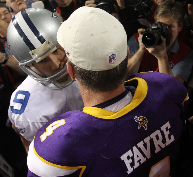 Quarterback Tony Romo #9 of the Dallas Cowboys congratulates quarterback Brett Favre #4 of the Minnesota Vikings on their 34-3 victory during the NFC Divisional Playoff Game at Hubert H. Humphrey Metrodome on January 17, 2010 in Minneapolis, Minnesota. photo appears  courtesy of Getty Images / Chris McGrath ....
