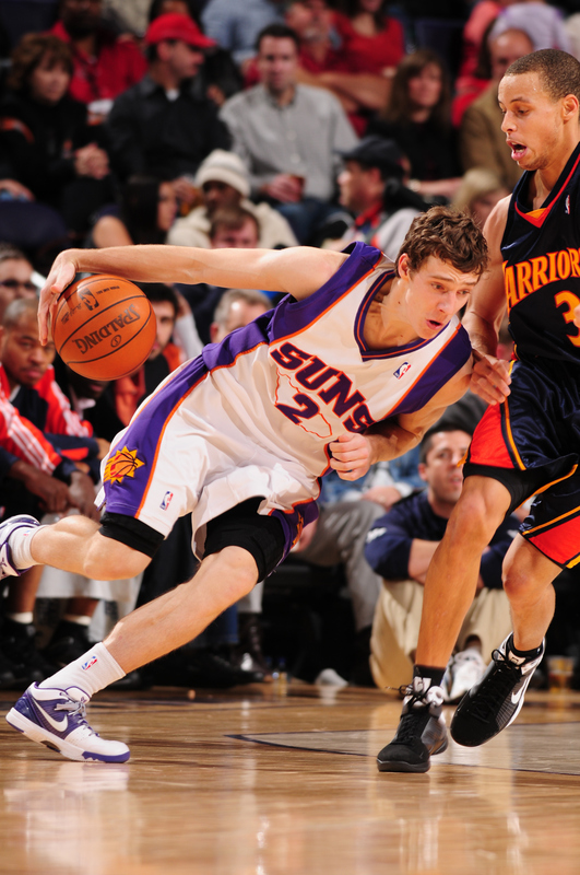 Goran Dragic (#2 )of the Phoenix Suns drives against Stephen Curry (#30) of the Golden State Warriors in an NBA Game played on January 23, 2010 at U.S. Airways Center in Phoenix, Arizona. photo appears   courtesy of NBAE/Getty  Images/  Barry  Gossage ...........