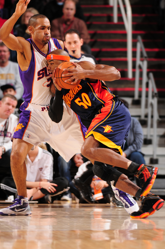 Corey Maggette (#50) of the Golden State Warriors drives against Grant Hill (#33) of the Phoenix Suns in an NBA Game played on January 23, 2010 at U.S. Airways Center in Phoenix, Arizona.   photo  appears   courtesy  of NBAE/ Getty Images/  Barry  Gossage ................