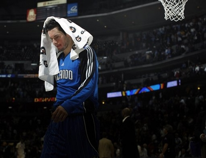 Orlando Magic guard J.J. Redick walks off the court after the Denver Nuggets' 115-97 victory over the Magic in an NBA basketball game in Denver on Wednesday, Jan. 13, 2010.  picture  appears courtesy  of  ap/photo/ David Zalubowski .....