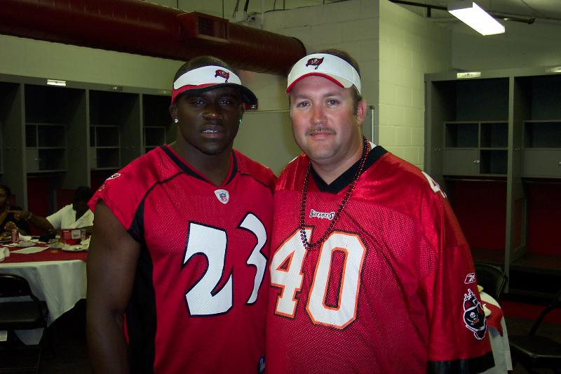 Bucs'  safety  Jermaine  Phillips (23)  seen  here  with  Tampa Bay Buccaneers'   fan  Robert McFarland at  the  team's  fanfest    held  Raymond  James  Stadium  in  Tampa  , Florida.   These are  the  sort  of   characters   from  the  Gruden  regime  that  in  essence  are  what  the  Bucs are  now  pinning  their  hopes on as to  the  immediacy  of  their   future.   Well  coming  off  a  3-13   season    , can  we  just  say  that  this   team and   Phillips   are clearly showing  that a  backbone   and  character  isn't  one  of their  strongest   traits  !     picture   appears  courtesy  of Tampa  Bay  Tribune  /  Pete  Clarke  .......................