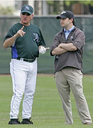 Joe Maddon  (left)  coach of  the  Tampa Bay  Rays  is  seen  here   with  Team  Snr  Vice  President  of  Operations  and  General  Manager   ,  Andrew  Friedman  .   The two  individuals   have   built  the  Rays  into a  formidable  and   competitive   organization  within the  AL   East .   picture  appears  courtesy  of  Sports   Illustrated / Associated  Press/  Tim  Dyson  ......................