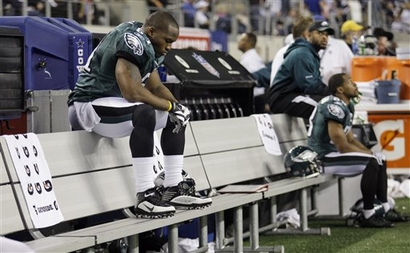 Philadelphia Eagles linebacker Joe Mays, left, sits on the bench during the closing minutes of an NFL wild-card playoff football game against the Dallas Cowboys, Saturday, Jan. 9, 2010, in Arlington, Texas. The Cowboys defeated the Eagles 34-14. picture  appears   courtesy  of  ap/photo/  David J Phillips ......