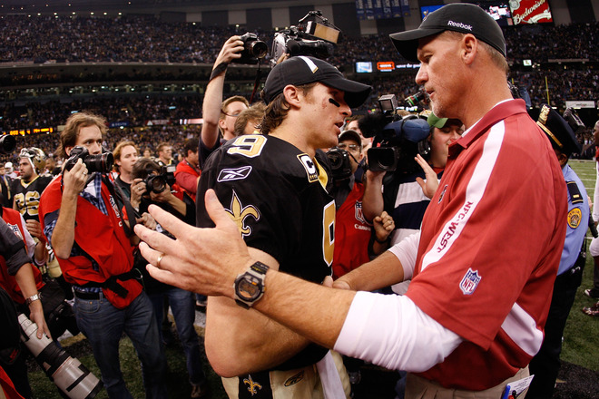 Drew Brees (#9) of the New Orleans Saints is congratulated by head coach Ken Whisenhunt of the Arizona Cardinals after the Siants won 45-14 during the NFC Divisional Playoff Game at Louisana Superdome on January 16, 2010 in New Orleans, Louisiana.  picture appears  courtesy  of   Getty Images/ Chris  Graythern  ...........