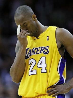 Los Angeles Lakers guard Kobe Bryant reacts in the final seconds of an NBA basketball game Thursday, Jan. 21, 2010, in Cleveland. The Cleveland Cavaliers won 93-87. photo appears courtesy of  Associated  Press/ Tony  Dejak  ............