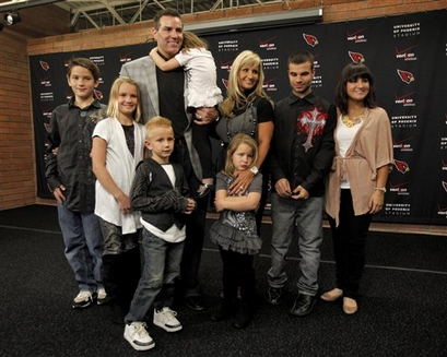 Arizona Cardinals quarterback Kurt Warner holds his daughter Sierra Warner, 4, as he stands with his family from left, Kade Warner, 11, Jada Warner, 8, Elijah Warner, 6, Sienna Warner, 4, wife Brenda Warner, Zack Warner, 20, and Jesse Warner, 18. after he announced his retirement from football Friday, Jan. 29, 2010 at the Cardinals' training facility in Tempe, Ariz. photo  appears  courtesy  of Associated  Press/ Matt York  .....