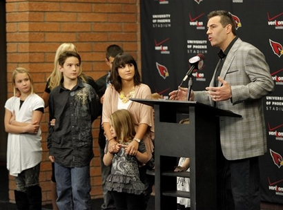 Arizona Cardinals quarterback Kurt Warner announces his retirement from football with his family Friday, Jan. 29, 2010 at the Cardinals' training facility in Tempe, Ariz. photo appears courtesy  of  Associated  Press / Matt  York ........