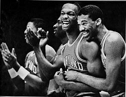 Len Bias  and (left) teammate   Derrick  Lewis of the  Maryland  Terrapins  have  something  to smile  about  during  a  college  basketball   game.      picture  appears   courtesy  of   ap/photo/  Russell  Hodges  ................