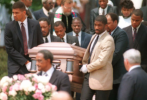 Friends and family carry Len Bias' casket out of a college chapel on the day of his funeral.