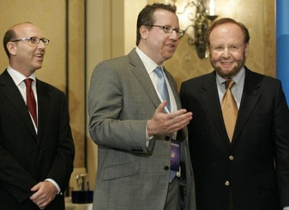Malcolm Glazer far right seen here with sons Joel (left) and Bryan. The family's sporting business interests includes the ownership of the NFL's Tampa Bay Buccaneers and the English Premiership League's Manchester United. picture appears courtesy of ap/photo/ Mike Nugent .......