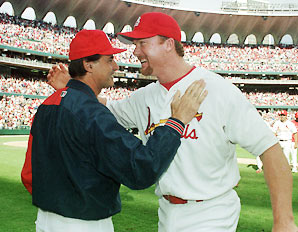 McGwire  (right) seen  here  with  then  manager , Tony  La  Russa of  the  St  Louis Cardinals.    McGwire  was  recently   hired  as  a  hitting  instructor  for  the  team.  Is  anyone  under  the  impression  that  Albert  Pujols  is  in   need  of    McGwirie's  assistance  when  it  comes  to  'hitting'   a  baseball  ?      picture  appears   courtesy  of   Sports  Illustrated and  AP/Photos/  Rod  Killion   ......................