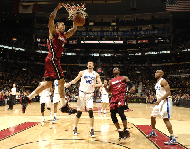 <strong> Michael Beasley (#30)</strong> of the Miami Heat throws down the dunk ahead of <strong>Hedo Turkoglu (#26)</strong>  of the Toronto Raptors during a game on January 27, 2010 at the Air Canada Centre in Toronto, Ontario, Canada.  <strong>photo  appears courtesy of NBAE/Getty Images/</strong>  Ron  Turner  ...............