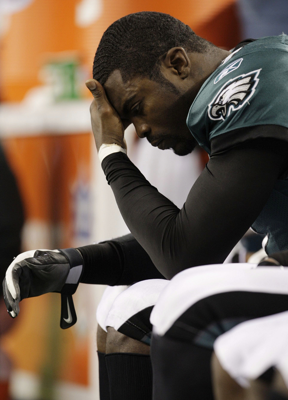 Quarterback Michael Vick (#7) of the Philadelphia Eagles looks down on the bench late in the fourth quarter against the Dallas Cowboys during the 2010 NFC wild-card playoff game at Cowboys Stadium on January 9, 2010 in Arlington, Texas. picture appears  courtesy of  Getty Images/ Jamie  Squire  .........