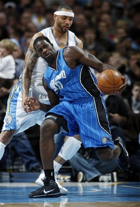 Orlando Magic forward Mickael Pietrus, front, of Guadeloupe, gets tangled up with Denver Nuggets forward Kenyon Martin in the fourth quarter of the Nuggets' 115-97 victory in an NBA basketball game in Denver on Wednesday, Jan. 13, 2010.  picture appears  courtesy  of  ap/photo/David Zalubowsk  .....