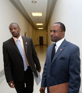 NFL Players Association Executive Director, DeMaurice Smith, right and Baltimore Ravens Domonique Foxworth, left, walk into a meeting  with House Judiciary Committee Chairman John Conyers, Jr., D-Mich., on Capitol Hill, Washington D.C. photo  appears  courtesy  of ap/ Alex Brandon   ........