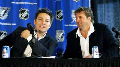 Principal  partner   in  the  ownership  group  of  the  NHL's Tampa  Bay Lightning   ,  Oren  Koules  (seated left)  is   seen  here  with  one   time   partner   Len  Barrie.   photo  appaers  courtesy  of  Associated  Press / Chris  O'Meara .......................
