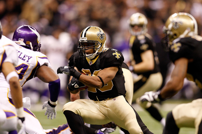 Pierre Thomas (#23) of the New Orleans Saints runs the ball against the Minnesota Vikings during the NFC Championship Game at the Louisana Superdome on January 24, 2010 in New Orleans, Louisiana. photo appears courtesy of Getty  Images/ Chris  Graythen  ......