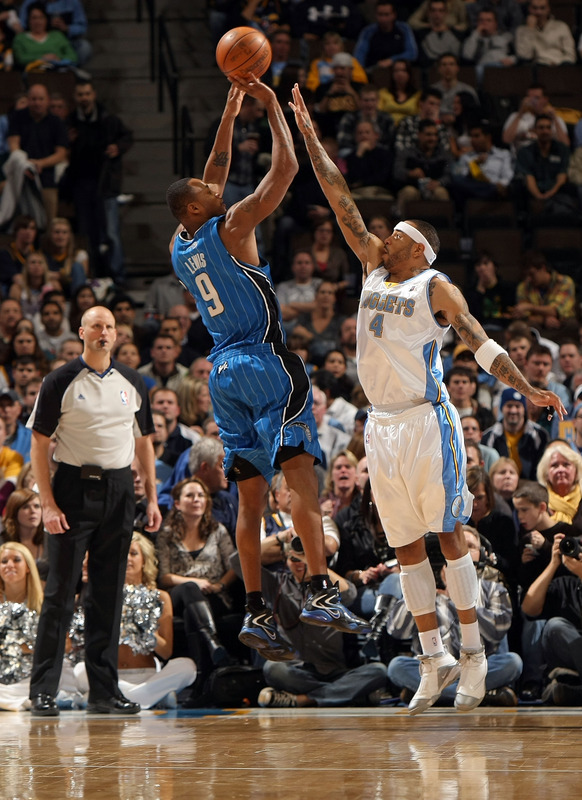 Rashard Lewis (#9) of the Orlando Magic takes a shot over Kenyon Martin (#4) of the Denver Nuggets during NBA action at Pepsi Center on January 13, 2010 in Denver, Colorado. The Nuggets defeated the Magic 115-97.   picture  appears  courtesy of  Getty Images/ Doug D  Pensinger  ...............