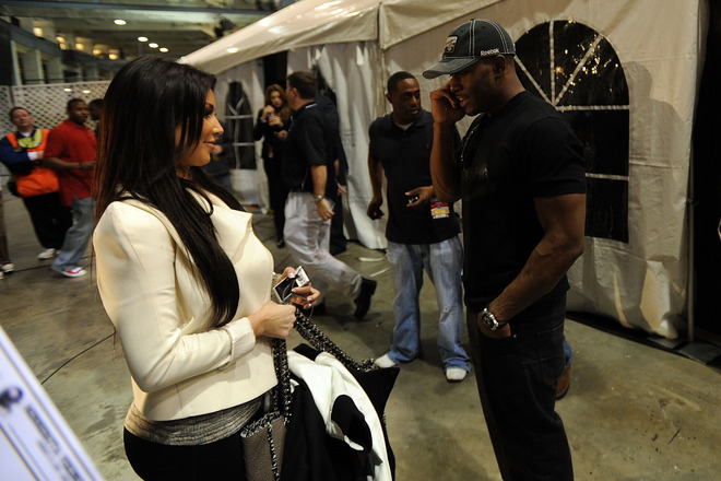 New Orleans January 24th 2010:  Kim Kardashian looks on as her boyfriend Reggie Bush (R) of the New Orleans Saints talks on the phone after his team's victory against the Minnesota Vikings to win the NFC Championship Game at the Louisana Superdome.  photo appears courtesy of  Getty  Images /  Michael Rourke .................