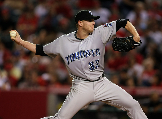 Roy  Halladay  formerly  of  the  Blue  Jays   is seen  here  pitching   for  the  team  in  AL  game  against  the  Los Angels  of  Anaheim  at  Anaheim  Stadium  in  May of   2009.     photo  appears   courtesy  of  Getty  Images/  Stephen  Dunn ..................
