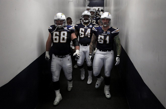 San Diego, Ca,. January 3rd 2010. Kris Dielman (#68), Dennis Norman (#64), and Nick Hardwick (#61) of the San Diego Chargers enter the field against the Washington Redskins during the Washington Redskins  v San Diego Chargers NFL Game on January 3, 2010 at Qualcomm Stadium in San Diego, California. The Chargers won 23-20. picture appears  courtesy of Getty Images/ Doug Miraelle  .......