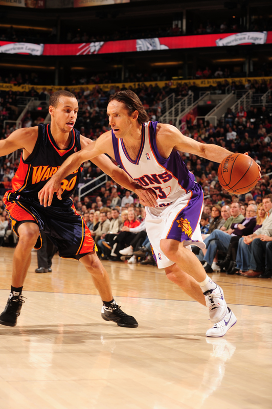 Steve Nash (#13) of the Phoenix Suns drives against Stephen Curry #30 of the Golden State Warriors in an NBA Game played on January 23, 2010 at U.S. Airways Center in Phoenix, Arizona. photo appears courtesy  of  NBAE/ Getty  Images/  Barry  Gossage  .........