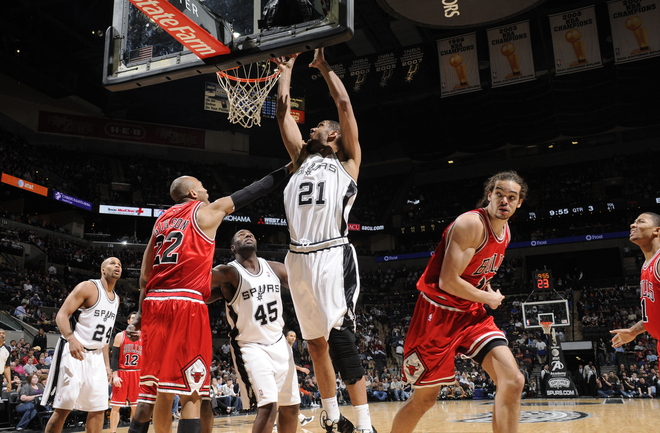 Tim Duncan (#21) of the San Antonio Spurs shoots against Taj Gibson (#22) of the Chicago Bulls on January 25, 2010 at the AT&T Center in San Antonio, Texas.
