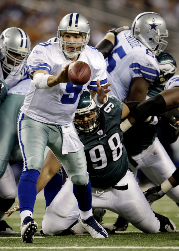 Tony Romo (#9 )of the Dallas Cowboys pitches the ball in the fourth quarter against the Philadelphia Eagles during the 2010 NFC wild-card playoff game at Cowboys Stadium. picture appears courtesy of  Getty Images/ Jamie Squire  ...........
