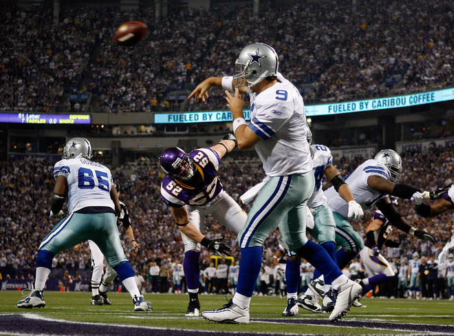 Quarterback Tony Romo (#9) of the Dallas Cowboys throws a pass as he comes under pressure from Chad Greenway (#52) of the Minnesota Vikings during the third quarter of the NFC Divisional Playoff Game at Hubert H. Humphrey Metrodome on January 17, 2010 in Minneapolis, Minnesota.  photo  appears  courtesy  of Getty Images/ Elsa  ......