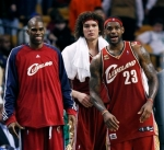 Cleveland Cavaliers players, from left, Antawn Jamison, Anderson Varejao, of Brazil, and LeBron Jamesin watch from the bench late in the fourth quarter of an NBA basketball game against the Boston Celtics, Thursday, Feb. 25, 2010, in Boston. The Cavaliers won 108-88.
