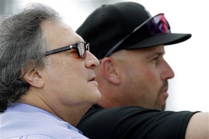 Florida Marlins owner Jeffrey Loria, left, watches batting practice with Marlins manager Fredi Gonzalez during spring training baseball Wednesday, Feb. 24, 2010, in Jupiter, Fla. With the smallest payroll in the majors last year, the Marlins won 87 games and finished six games behind eventual league champion Philadelphia in the NL East. Visiting spring training to watch the first full-squad workout, Loria said the 2009 Marlins underachieved.  photo  appears  courtesy of  Assoc  Press/Jeff Roberson   ........