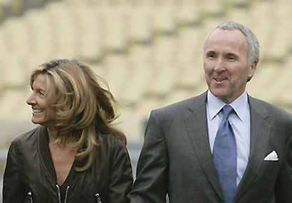 <strong> Frank <em> and </em> Jamie McCourt </strong></em>.   The  couple  are   now  in  the  midst  of  a <strong> very  contentious  divorce </strong> which  could  have  <strong> some very  <em> serious   ramifications</em>  for  the  Los  Angeles  Dodgers'   franchise</strong>    from  the  possible  impending verdict   by  the   judge   in  the   case.    photo  appears   courtes of  Associated  Press/  Richard   Franklin  .....