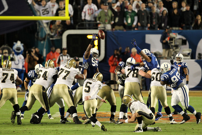 <strong> Garrett Hartley (#5) </strong> of the New Orleans Saints kicks a field goal as <strong> Mark Brunell (#11)</strong> holds against the Indianapolis Colts during Super Bowl XLIV on February 7, 2010 at Sun Life Stadium in Miami Gardens, Florida.  photo appears courtesy  of  <strong> Getty Images</strong>/  Ezra   Shaw ..........
