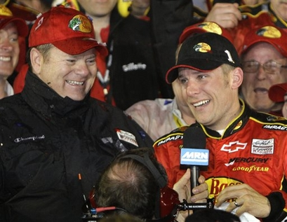 Team owner Chip Ganassi, left, and NASCAR driver Jamie McMurray are interviewed after winning the Daytona 500 auto race at Daytona International Speedway in Daytona Beach, Fla.  photo appears  courtesy of  Associated  Press/ John  Raoux .......