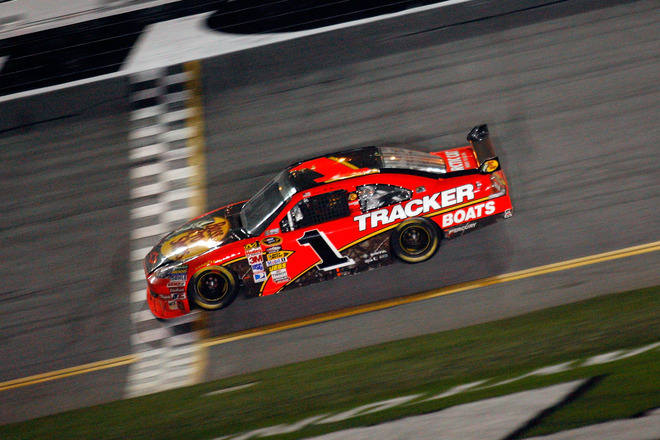 Jamie McMurray, driver of the (#1) Bass Pro Shops/Tracker Boats Chevrolet, crosses the finish line to win the the NASCAR Sprint Cup Series Daytona 500 at Daytona International Speedway on February 14, 2010 in Daytona Beach, Florida.  photo appears courtesy  of Getty Images/  NASCAR/ Jason  Smith ..................
