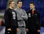 New Orleans Saints quarterback coach Joe Lombardi, center, talk with Texas' Colt McCoy, left, and Florida's Tim Tebow during drills at the NFL football scouting combine in Indianapolis, Sunday, Feb. 28, 2010.
