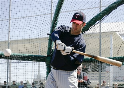 Minnesota Twins pitcher Joe Mauer swings in the batting cage  at baseball spring training in Fort Myers, Fla., Thursday, Feb. 25, 2010. photo appears courtesy of  Assoc Press/ Nati Harnik  .......