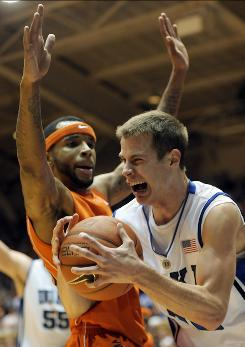 Duke's Jon Scheyer collides with Virginia Tech's Malcolm Delaney, left, during the first half. Scheyer scored 25 points and collected 10 rebounds in the win.