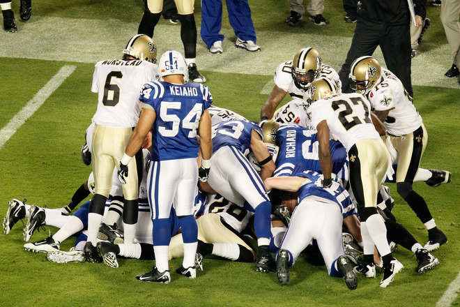 The Indianapolis Colts fights for a loose ball against the New Orleans Saints after an onside kick to start the second half during Super Bowl XLIV on February 7, 2010 at Sun Life Stadium in Miami Gardens, Florida. photo  appears  courtesy  of  <strong>Getty Images/ </strong>  Doug Benc .....