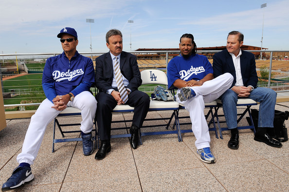 Manny Ramirez #99 (2R) of the Los Angeles Dodgers manager Joe Torre #6 (L) general manager Ned Colletti and Ramirez's agent Scott Boras looks on during a news conference on March 5, 2009, at Camelback Ranch in Glendale, Arizona, after he re-signed with the Dodgers.